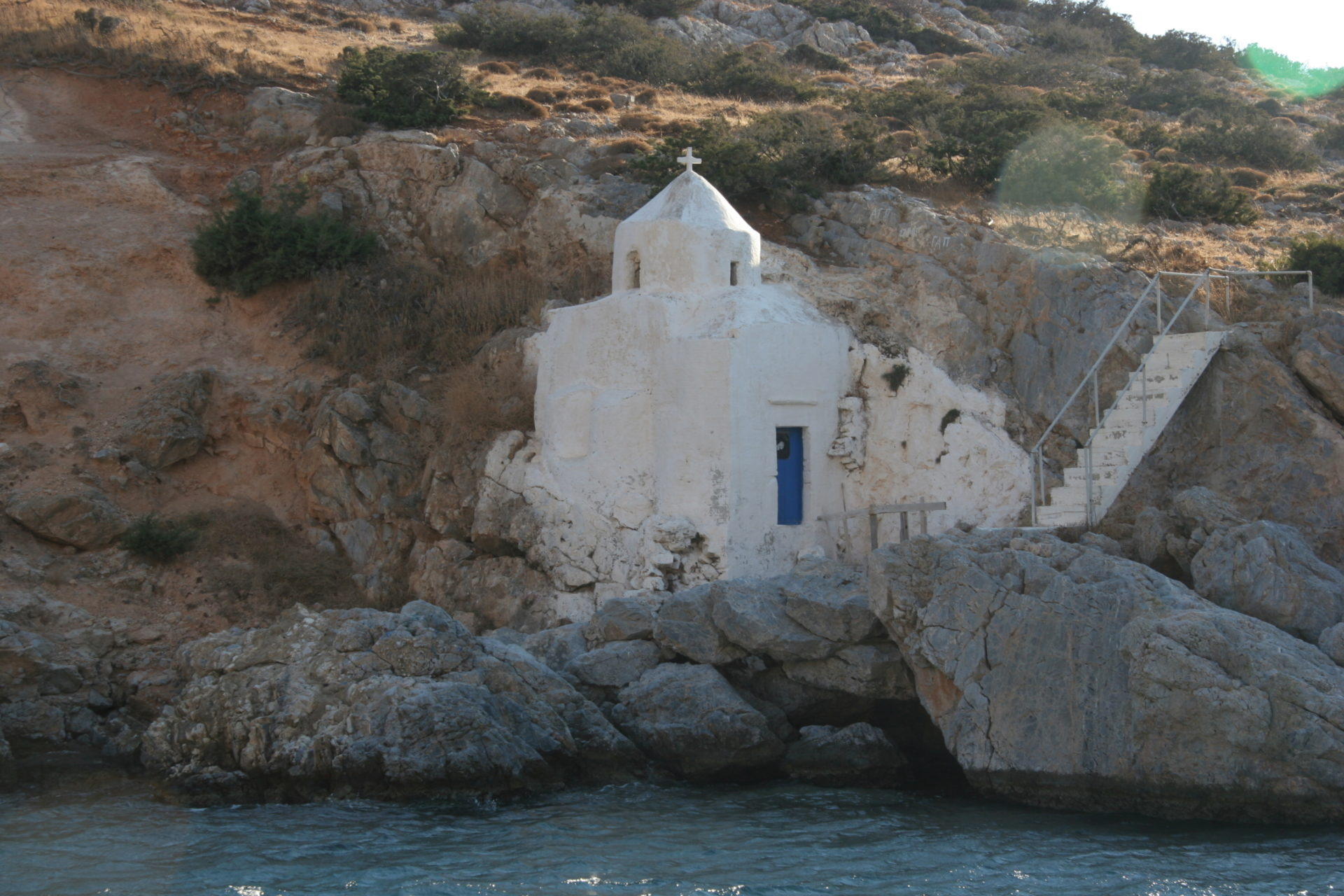 """discover small Cycladic chapels """"hanging"""" from cliffs"""